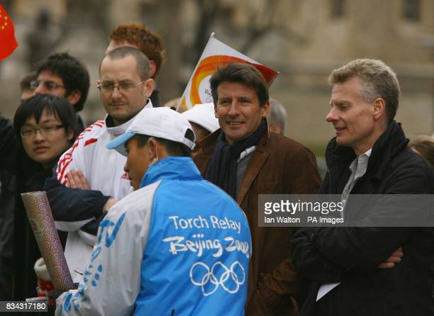 London Organising Committee for the Olympic Games Chairman Lord Sebastian Coe watches as the Olympic torch makes its relay journey across London on...