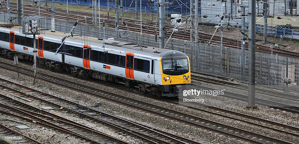 A London Overground Operations Ltd. train arrives at Paddington railway station in London, U.K., on Thursday, Jan. 3 2013. Rail commuters have been hit by inflation busting fare increases of up to 10 per cent, adding hundreds of pounds to the cost of annual season tickets. Photographer: Chris Ratcliffe/Bloomberg via Getty Images