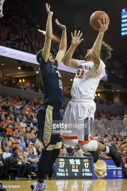 London Perrantes of the Virginia Cavaliers goes to the basket past Cameron Johnson of the Pittsburgh Panthers during a game at John Paul Jones Arena...
