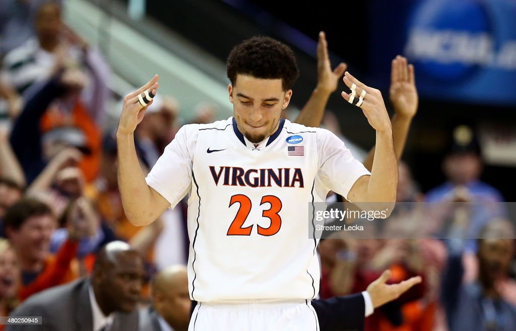 London Perrantes of the Virginia Cavaliers reacts after a play in the first half against the Memphis Tigers during the third round of the 2014 NCAA...