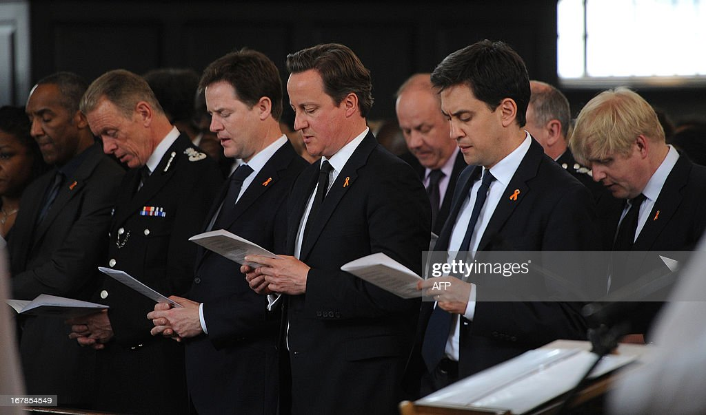 London Police Comissioner Bernard Hogan-Howe, British Deputy Prime Minister Nick Clegg, British Prime Minister David Cameron and opposition Labour Party leader Ed Miliband attend a memorial service commemorating the 20th anniversary of the racist killing of British teenager Stephen Lawrence at St Martin-in-the-Fields church in central London on April 22, 2013. Lawrence, 18, was murdered by a gang of racists who stabbed him as he waited for a bus in Eltham, south-east London on April 22, 1993.