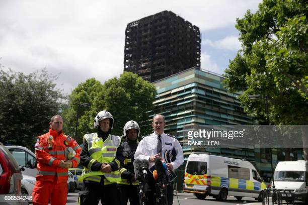London Police Commander Stuart Cundy makes a statement to the media against the backdrop of the remains of Grenfell Tower a residential tower block...