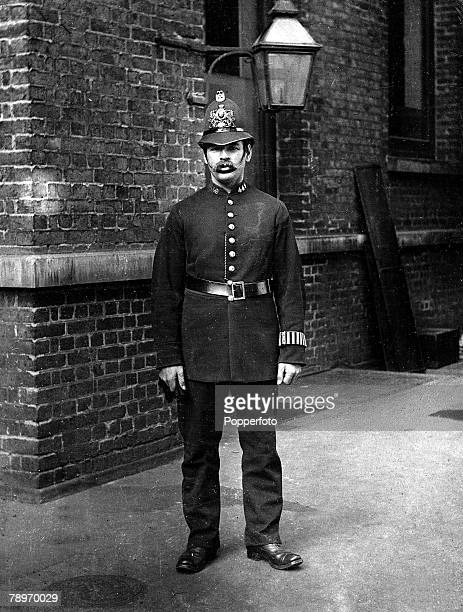 A London policeman wears the uniform of a late 19th century City of London police officer