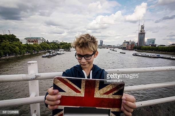 UK, London, portrait of boy taking a selfie with his digital tablet