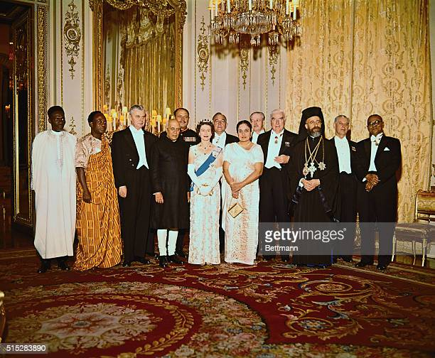 Queen Elizabeth II poses with Commonwealth ministers at Buckingham Palace here March 16th where all attended a dinner shown in the photo are...
