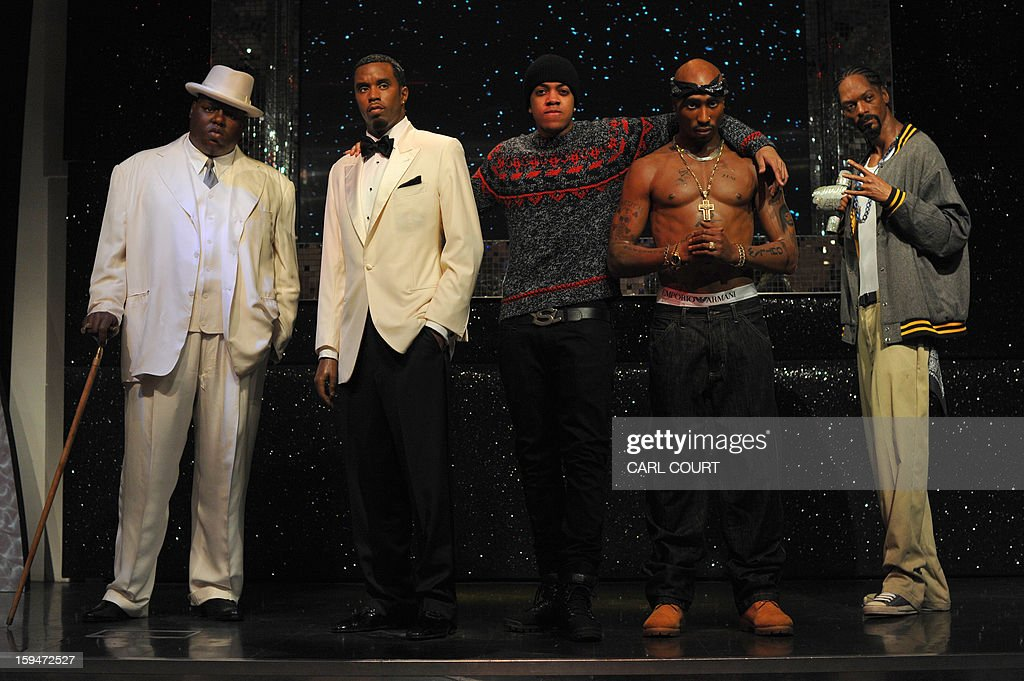 London rapper, Chip (C), poses with wax figures of US rappers (L-R) The Notorious B I G, P Diddy, Tupac Shakur and Snoop Dogg at Madame Tussauds in central London on January 14, 2013 to launch a new exhibit featuring the four wax East and West Coast US rappers.