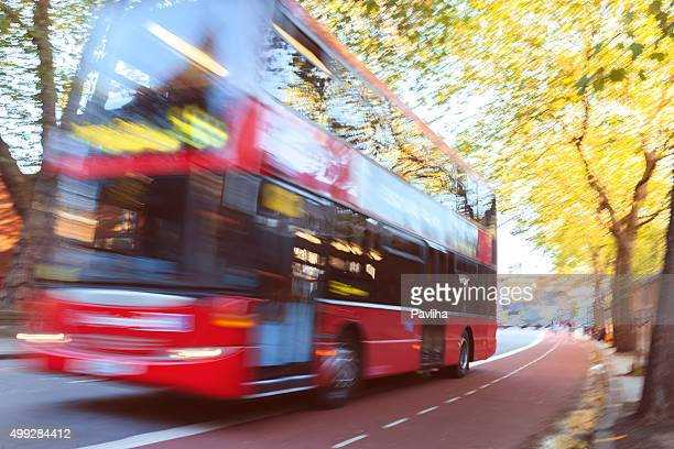 London Red Double Decker Bus Driving at street,abstract,UK