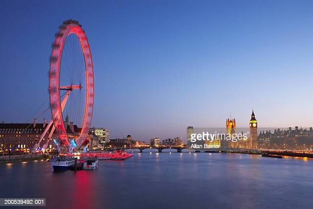 UK, London, River Thames, Millennium Wheel illuminated at dusk