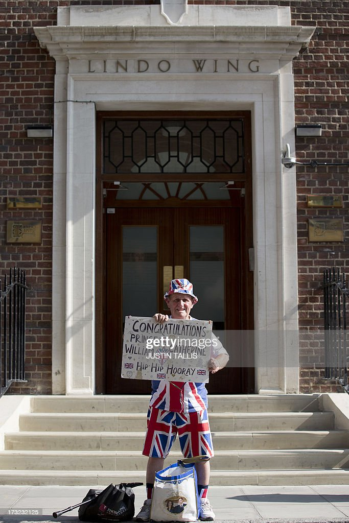 Royal supporter Terry Hutt poses for a photograph as he arrives to stake his place outside The Lindo Wing of Saint Mary's Hospital in London on July 10, 2013. Prince William and his wife Catherine's baby, which will be third in line to the throne, will be born in the private Lindo wing of St Mary's Hospital, where William was born in 1982 and his brother Harry in 1984.