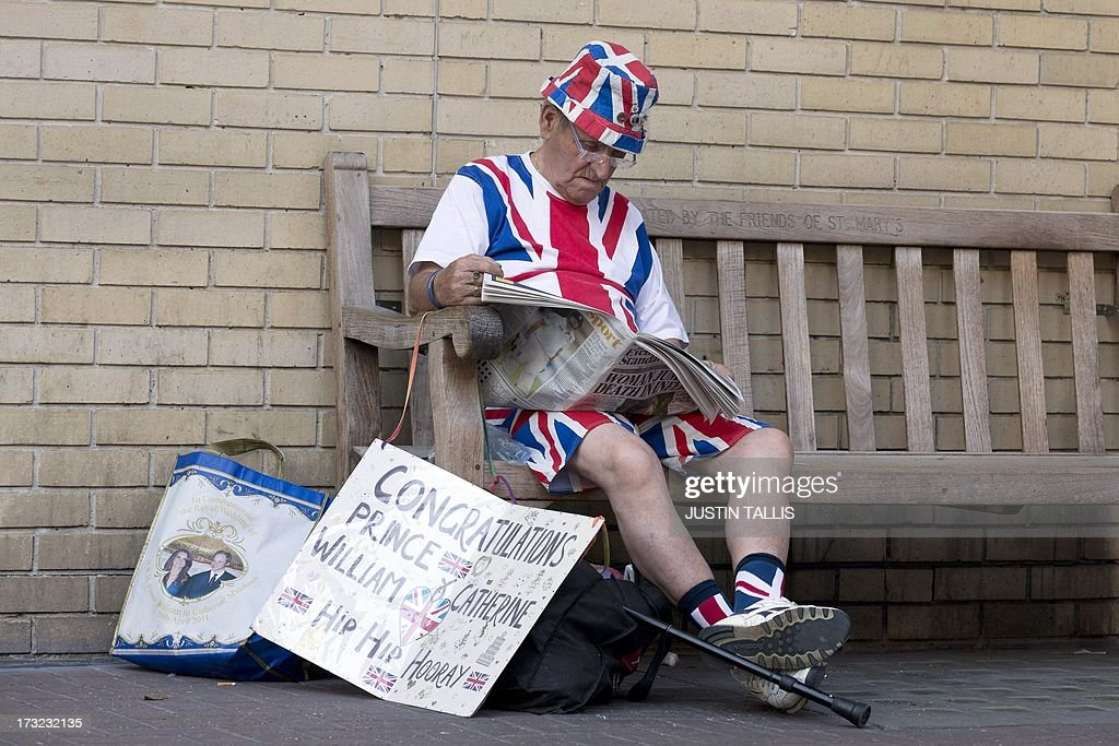 Royal supporter Terry Hutt sits on a bench reading a newspaper outside The Lindo Wing of Saint Mary's Hospital in London on July 10, 2013. Prince William and his wife Catherine's baby, which will be third in line to the throne, will be born in the private Lindo wing of St Mary's Hospital, where William was born in 1982 and his brother Harry in 1984.