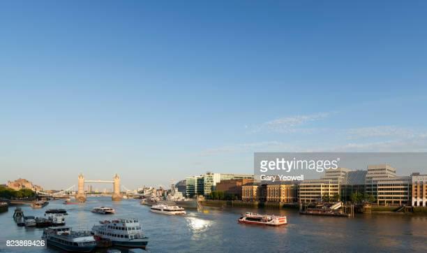 London skyline along River Thames by Tower Bridge