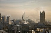 Landscape photo looking out over the buildings, to the Shard, Westminster and Big Ben - steam rising form the buildings.