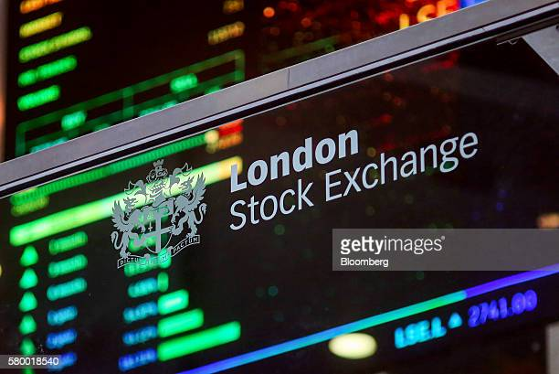 A London Stock Exchange sign sits on glass in the atrium of the London Stock Exchange Group Plc's offices in Paternoster Square in London UK on...