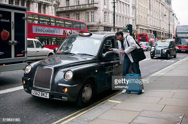 London taxi cab and a passenger