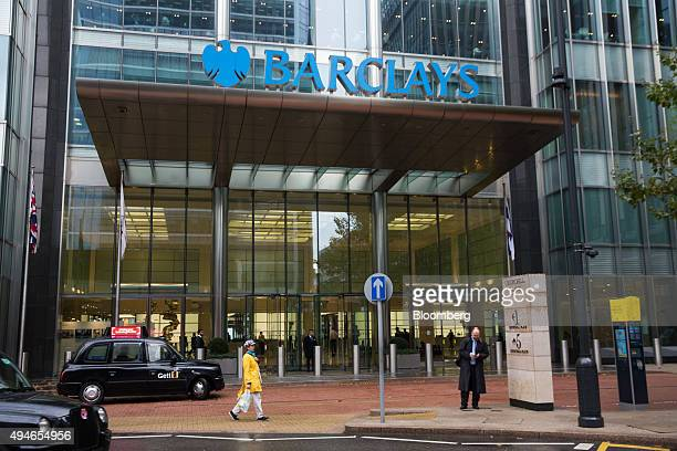 A London taxi cab sits in front of the Barclays Plc headquarters in the Canary Wharf business financial and shopping district of London UK on...