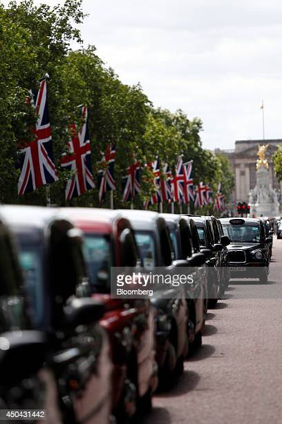 London taxi cabs stand parked along The Mall leading away from Buckingham Palace during a protest against Uber Technologies Inc's car sharing service...
