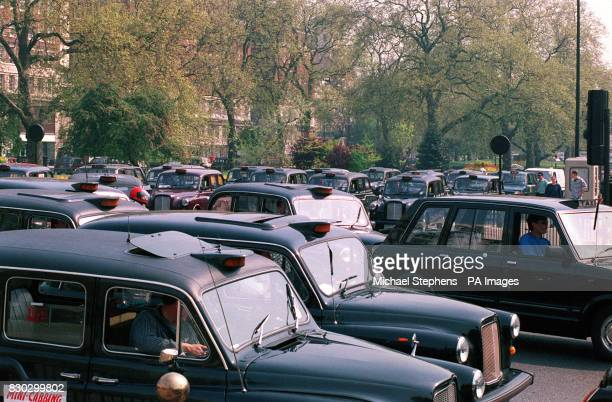 London taxi drivers gather at Hyde Park in their cabs to protest at the Government's plans to license the capital city's minicabs *24/02/04 Taxi...