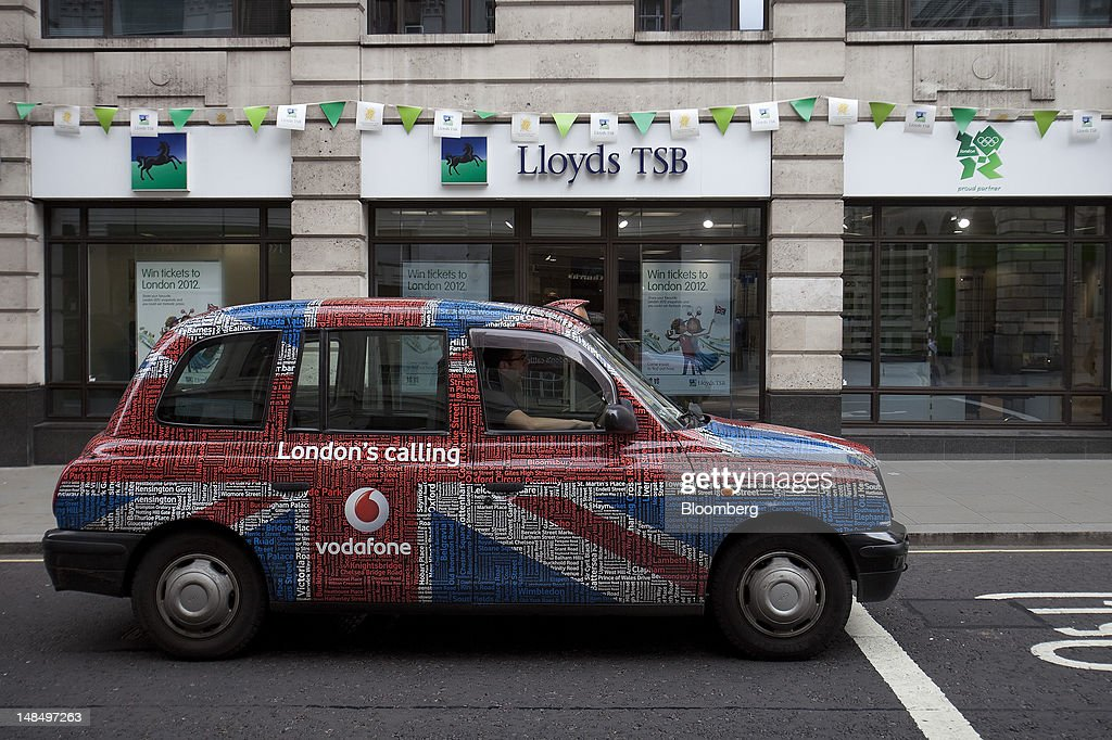 A London taxi drives past a Lloyds TSB bank branch, part of the Lloyds Banking Group Plc, in London, U.K., on Wednesday, July 18, 2012. The U.K. financial regulator said it's investigating seven lenders over attempts to manipulate interbank offered rates as lawmakers criticized it for not opening the probe earlier. Photographer: Simon Dawson/Bloomberg via Getty Images