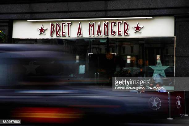 A London taxi pass the Trafalgar Square branch of sandwich shop Pret A Manger in central London