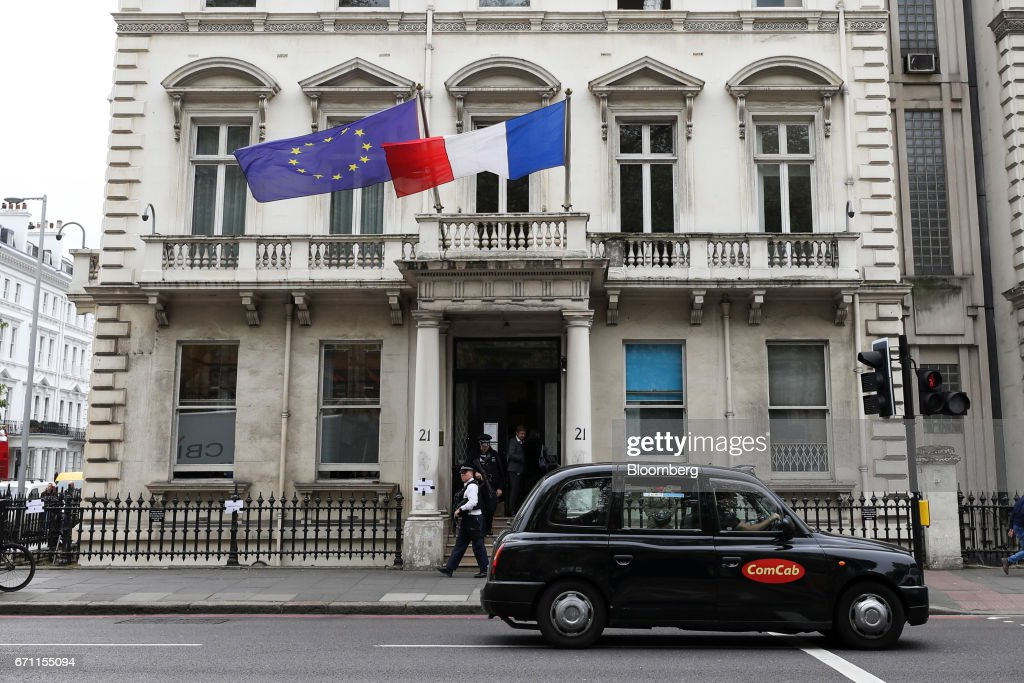 A London taxi passes the French consulate in London, U.K., on Friday, April 21, 2017. Three days before the first round of voting for their next president, a line snakes around a block in South Kensington, one of the most expensive and iconic neighborhoods in the city that also happens to be the epicenter of the French community -- home to its consulate, a school and various bistros and cafes that cater to the 300,000 French expats living in the U.K. Photographer: Chris Ratcliffe/Bloomberg via Getty Images