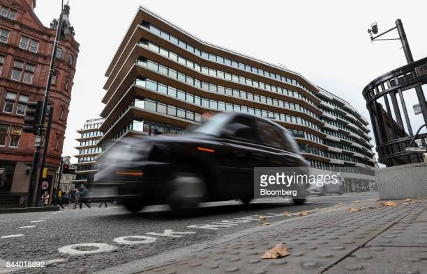 A London taxi passes the offices which house the headquarters of Bell Pottinger LLP in London UK on Tuesday Sept 5 2017 Bell Pottinger LLP's attempt...