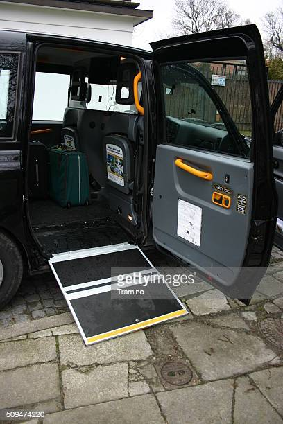 London taxi with open door and wheelchair ramp