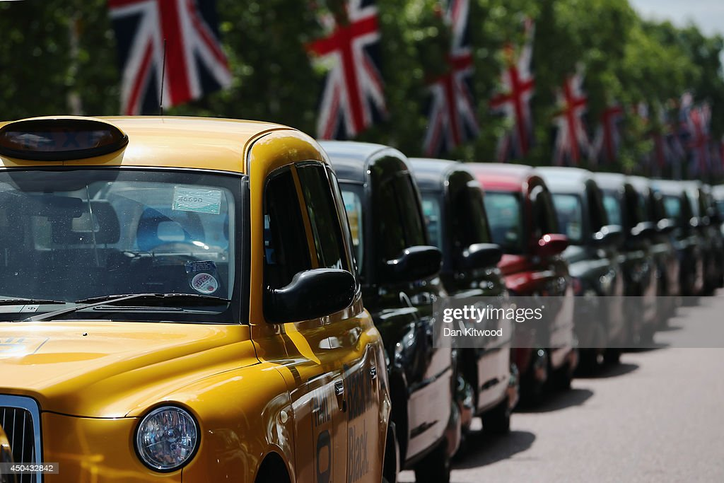 A London taxi's line up on The Mall during a protest against a new smart phone app, 'Uber' on June 11, 2014 in London, England. London's licensed black taxi drivers are campaigning against the introduction of the 'Uber' taxi smartphone app in the United kingdom. Drivers say that there is a lack of regulation behind the new app.