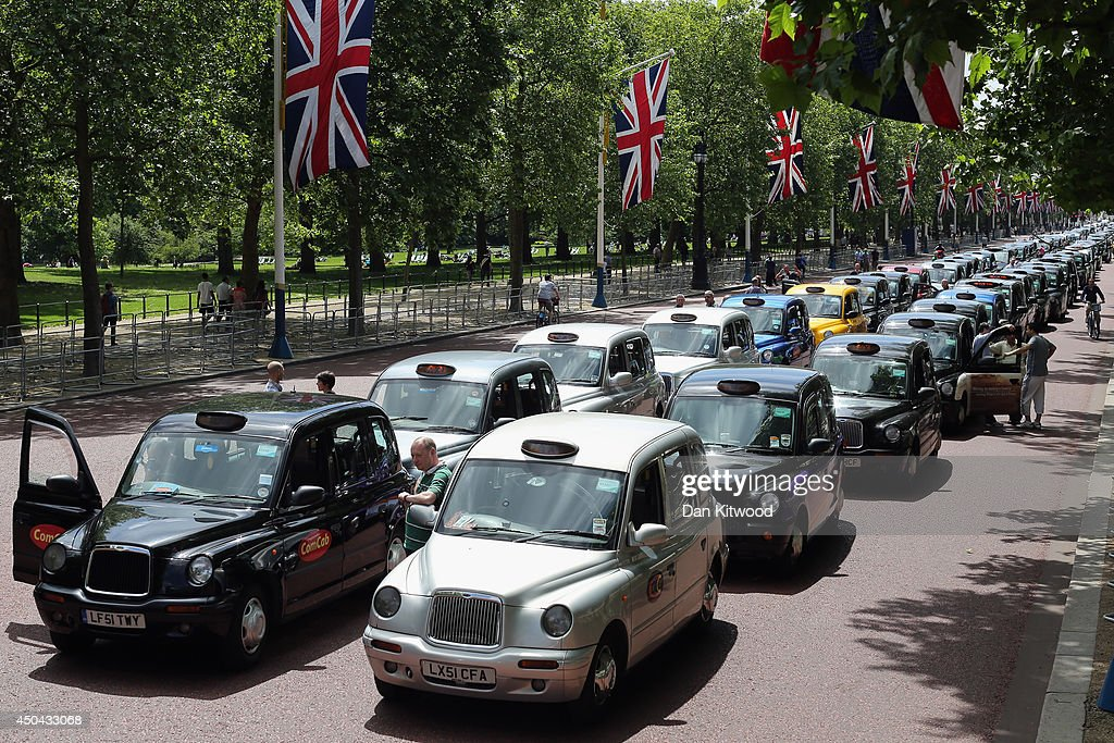 London taxis line up on The Mall during a protest against a new smart phone app, 'Uber' on June 11, 2014 in London, England. London's licensed black taxi drivers are campaigning against the introduction of the 'Uber' taxi smartphone app in the United kingdom. Drivers say that there is a lack of regulation behind the new app.
