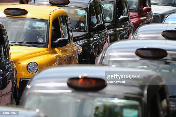 London taxis line up on The Mall during a protest against a new smart phone app 'Uber' on June 11 2014 in London England London's licensed black taxi...