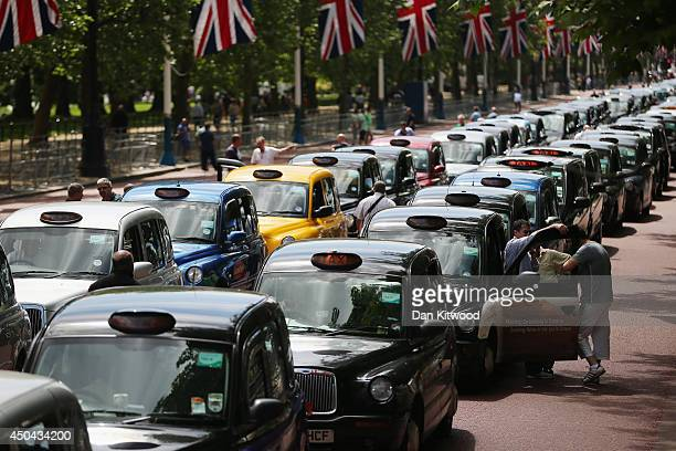 London taxi's line up on The Mall during a protest against a new smart phone app 'Uber' on June 11 2014 in London England London's licensed black...