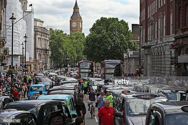 London taxis line up on Whitehall during a protest against a new smart phone app 'Uber' on June 11 2014 in London England London's licensed black...