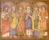 London -  The tiled mosaic of Apostles and saints in church All Saints designed by Butterfield and painted by Alexander Gibbs (1873).
