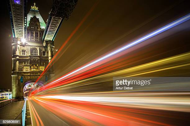 London Tower Bridge at night with bus lights speed