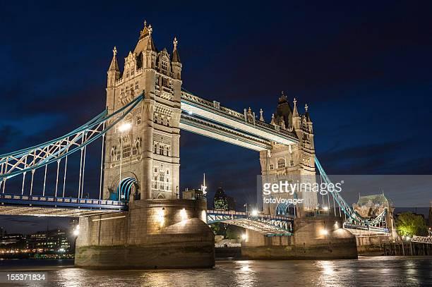 London Tower Bridge illuminated over River Thames at dusk