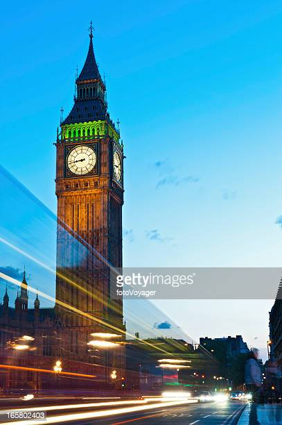 London traffic rushing past Big Ben Westminster Bridge UK