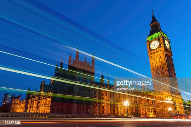 London traffic zooming past Big Ben Westminster Parliament