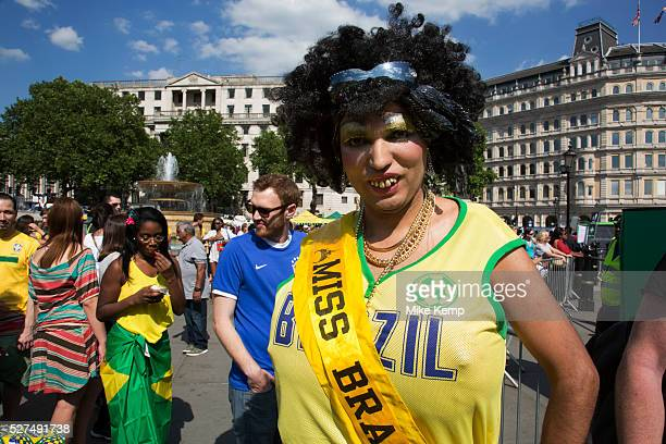 London UK Thursday 12th June 2014 A grotesque Miss Brazil drag beauty queen with wig and buck teeth and giant fake breasts Brazilians gather for the...