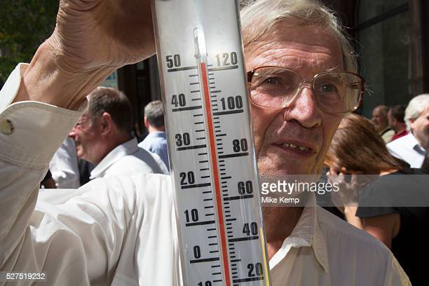 London UK Thursday 5th September 2013 Man with a thermometer shows the temperature exceeding 50 degrees C beyond the limit of his guage Urgent action...