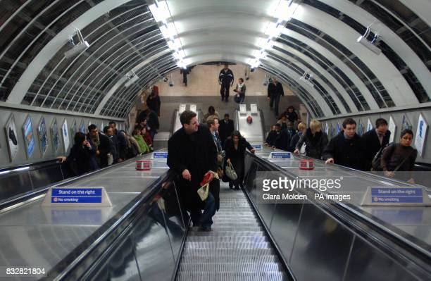 London Underground commuters climb the escalators at Bond Street tube station Central London
