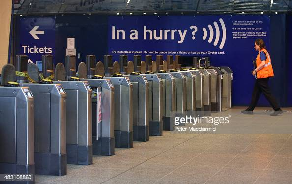 London Underground employee is glimpsed at a deserted Waterloo Tube Station on August 6 2015 in London England London Underground workers are staging...