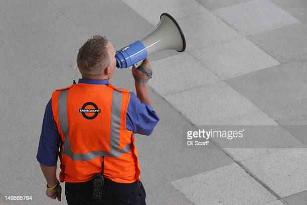 London Underground employee makes an announcement to rail passengers passing through Stratford Station adjacent to the Olympic Park on July 31 2012...