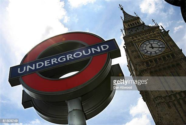 A london Underground sign sits under Big Ben on 4 June 2008 in London England