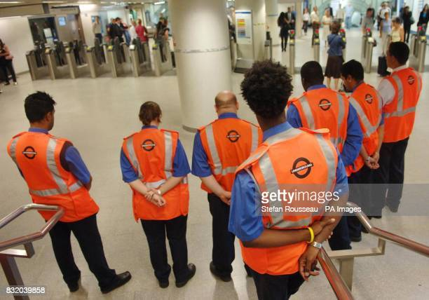 London Underground staff and commuters stop for a two minutes silence in Kings Cross Tube station London as the capital remembers last years...