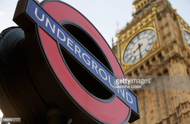 A London Underground Station sign is pictured against the backdrop of the Houses of Parliament in London on February 5 on the first day of a strike...
