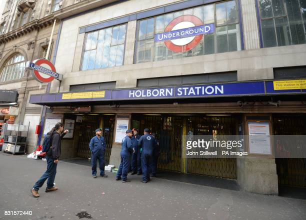 London Underground workers stand outside a closed Holborn tube station in London where engineers are checking a faulty train