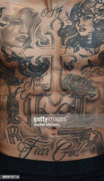 London United Kingdom 12 December 2017 A detailed view of the tatoos on the body of boxer Conor Benn as he weighs in at the Courthouse Hotel in...