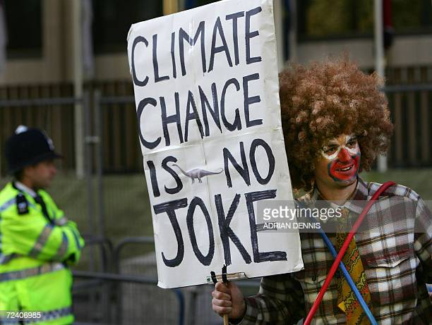 A campaigner displays a message on a placard in Grosvenor Square near the US Embassy ahead of a march as part of global protests calling for world...
