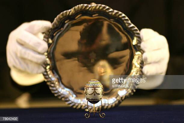 A Faberge jewelled egg owned by King George 1 of Greece sits in front of a silver salver at Christie's auction house in central London 19 January...