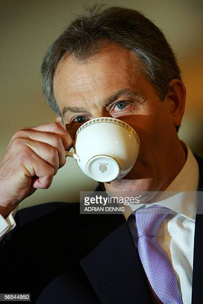A file photo taken 12 May 2005 shows Britain's Prime Minister Tony Blair drinking a cup of tea during his monthly press conference at No10 Downing...