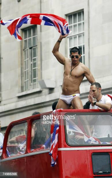 A man waves the British flag during the Gay Pride march in London 30 June 2007 Londoners shrugged off the latest terror threats today as half a...
